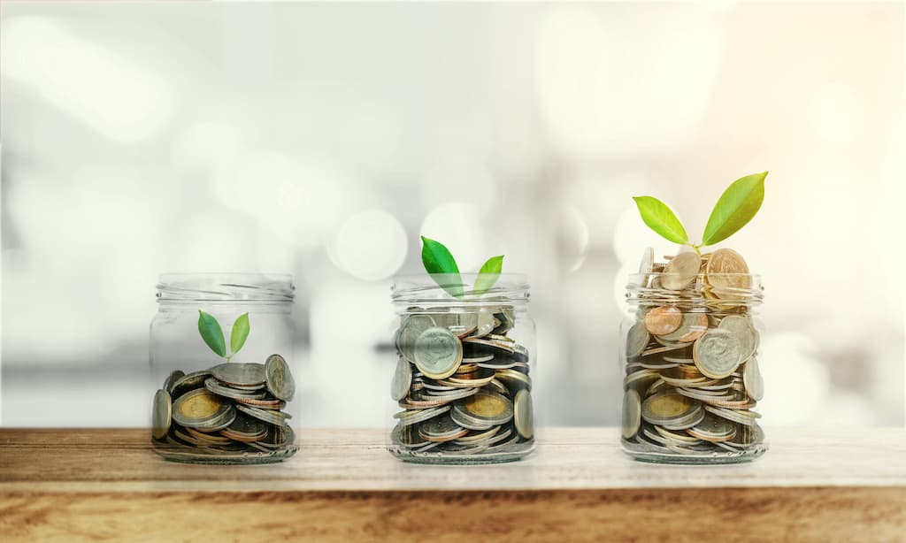 Three jars containing coins and plants, representing how cash flow or component funding methods increase reserve fund balances.