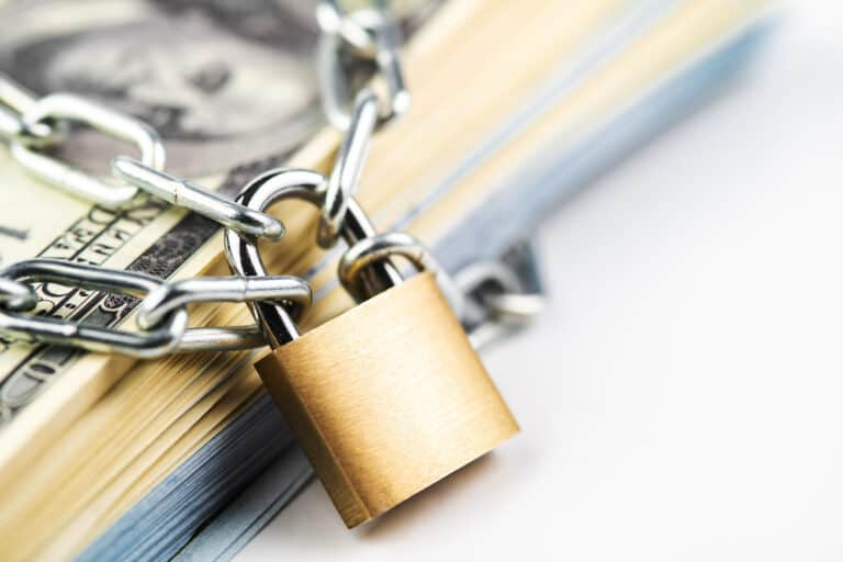 Money with lock, representing how AB 1101 insures and protects HOA funds.